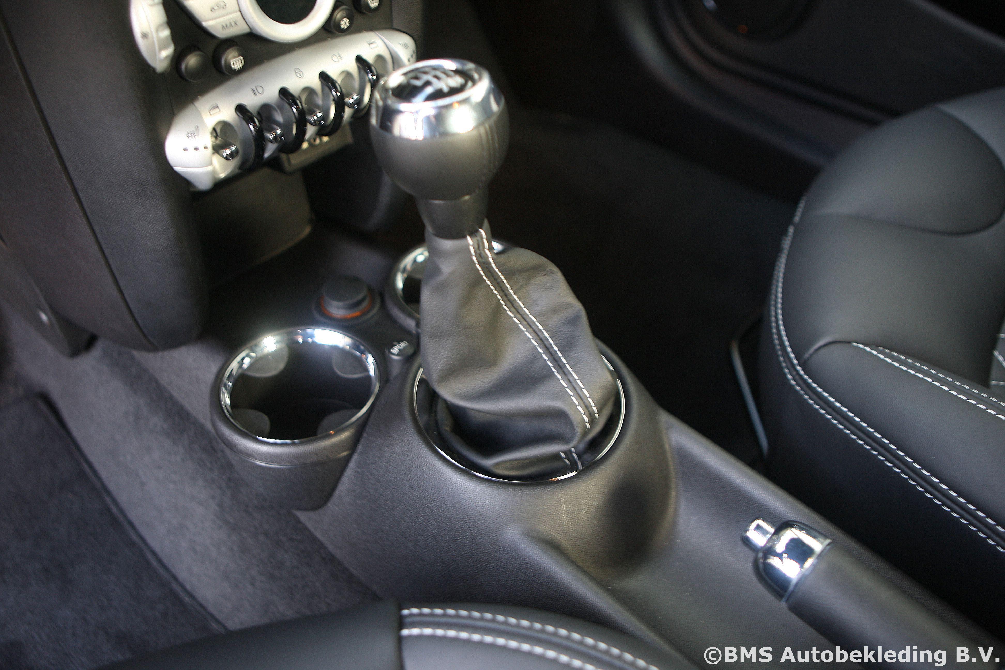 http://www.bmsautobekleding.nl/wp-content/uploads/2011/09/MINI-Cooper-S-2010-Tailor-Made-Aston-Martin-Kroymans-8.jpg